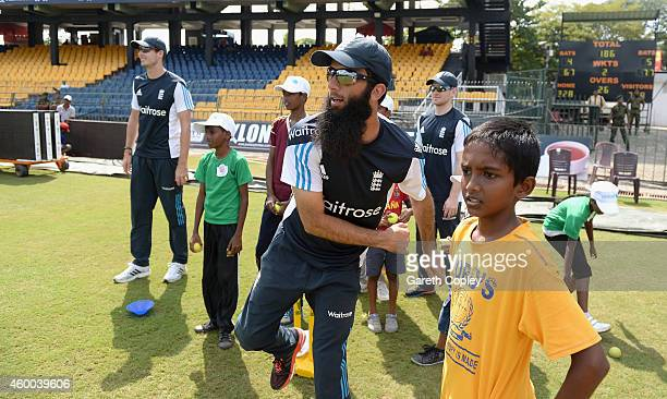 Moeen Ali of England coaches local children during a charity event at R. Premadasa Stadium on December 6, 2014 in Colombo, Sri Lanka.