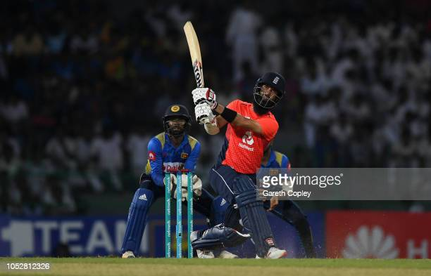 Moeen Ali of England hits out for six runs during the 5th One Day International match between Sri Lanka and England at R Premadasa Stadium on October...