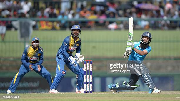 Moeen Ali of England hits out for six runs during the 6th One Day International match between Sri Lanka and England at Pallekele Cricket Stadium on...