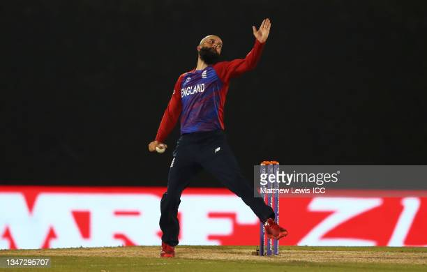 Moeen Ali of England in bowling action during the India and England warm Up Match prior to the ICC Men's T20 World Cup at on October 18, 2021 in...