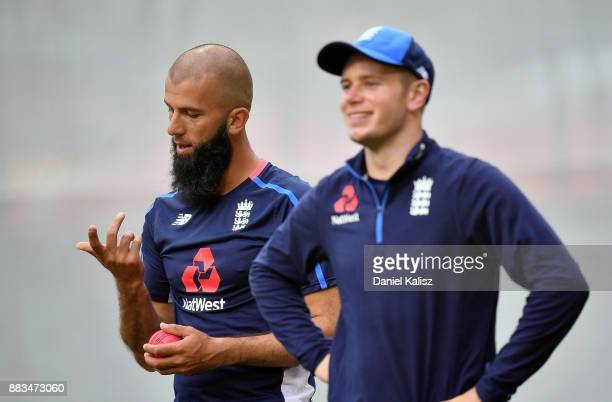 Moeen Ali of England inspects his finger as Mason Crane of England looks on during an England nets session at Adelaide Oval on December 1 2017 in...