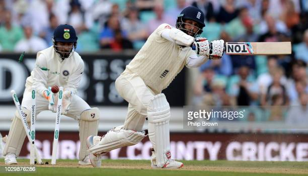 Moeen Ali of England is bowled as Rishabh Pant of Indoia looks on during the third day of the fifth Specsavers Test Match between England and India...