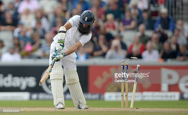 Moeen Ali of England is bowled by Varun Aaron of India during day two of 4th Investec Test match between England and India at Old Trafford on August...