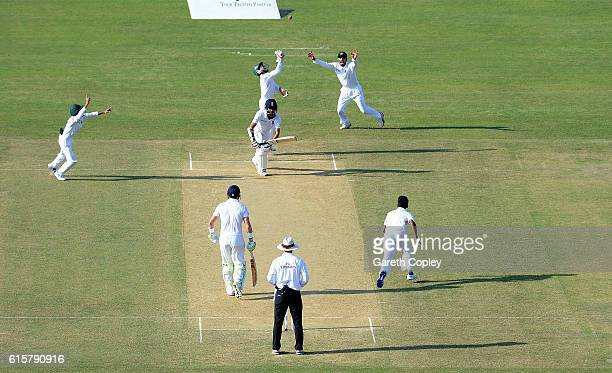 Moeen Ali of England is caught behind by Bangladesh wicketkeeper Mushfiqur Rahim from the bowling of Mehedi Hasan during the first Test match between...