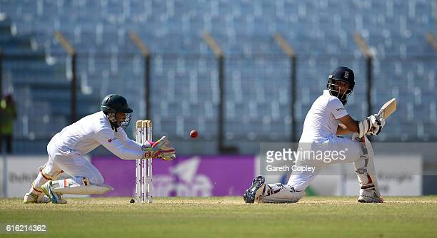 Moeen Ali of England is caught out Bangladesh wicketkeeper Mushfiqur Rahim during the 3rd day of the 1st Test match between Bangladesh and England at...