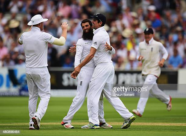Moeen Ali of England is congratulated by captain Alastair Cook after taking the wicket of David Warner of Australia during day one of the 2nd...