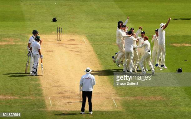 Moeen Ali of England is congratulated by teammates after taking the wicket of Morne Morkel of South Africa for his hattrick during day five of the...