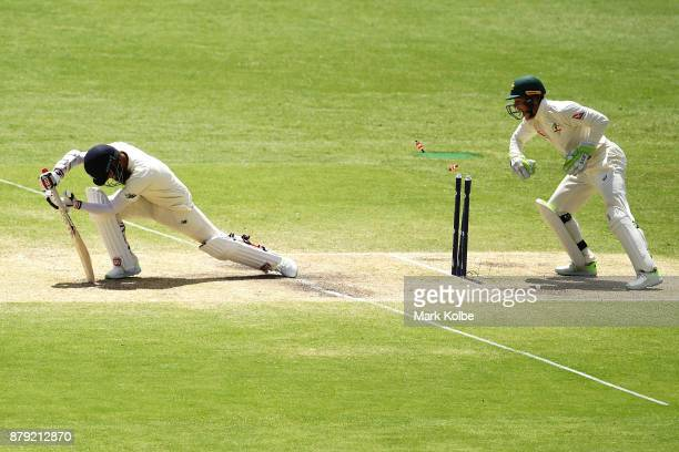 Moeen Ali of England is stumped by Tim Paine of Australia during day four of the First Test Match of the 2017/18 Ashes Series between Australia and...