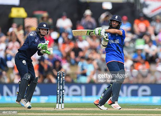 Moeen Ali of England plays a shot as Scotland wicketkeeper Matthew Cross looks on during the 2015 ICC Cricket World Cup match between England and...
