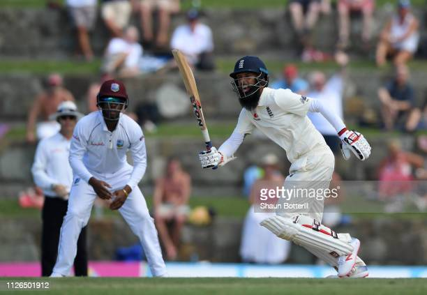 Moeen Ali of England plays a shot during Day One of the 2nd Test match between West Indies and England at Sir Vivian Richards Stadium on January 31,...