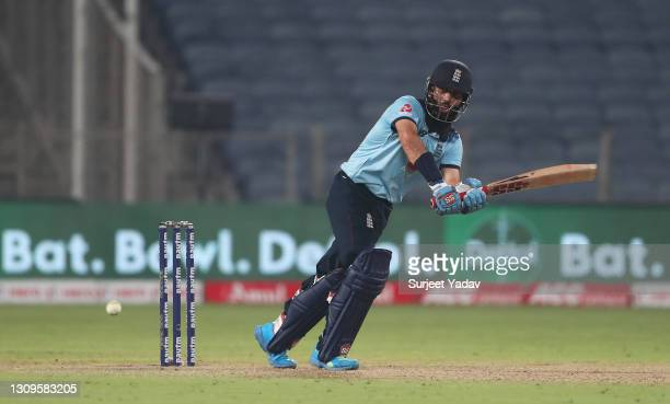 Moeen Ali of England plays a shot during the 3rd One Day International match between India and England at MCA Stadium on March 28, 2021 in Pune,...