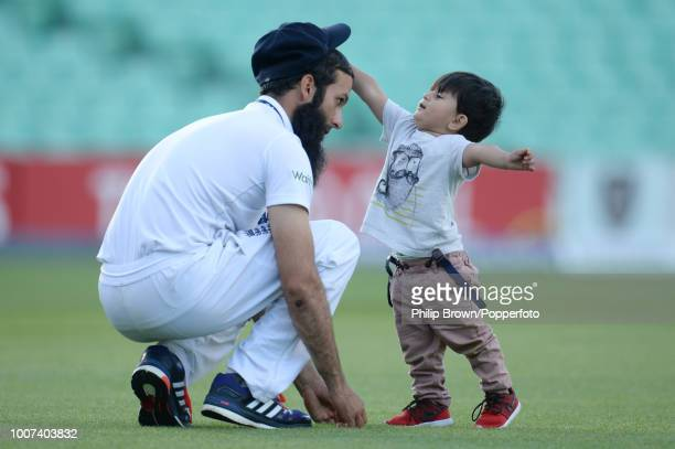 Moeen Ali of England plays with his son Abu Bakr Ali on the outfield after the 5th Ashes Test match between England and Australia at The Oval London...