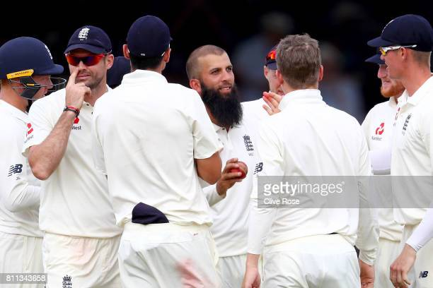 Moeen Ali of England raises the match ball after taking five wickets on day four of the 1st Investec Test match between England and South Africa at...