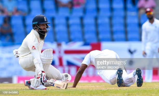 Moeen Ali of England returns to his crease during day 1 of the 2nd Test between West Indies and England at Vivian Richards Cricket Stadium in North...