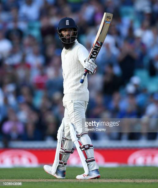 Moeen Ali of England salutes the crowd after reaching his half century during day one of the Specsavers 5th Test between England and India at The Kia...