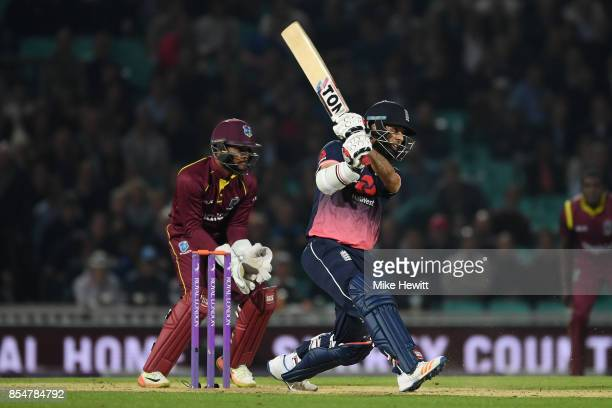 Moeen Ali of England smashes a four during the 4th Royal London One Day International between England and West Indies at The Kia Oval on September 27...