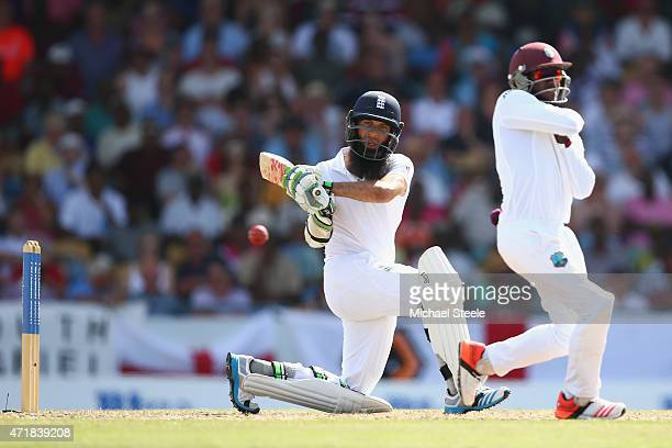 Moeen Ali of England sweeps as Jermaine Blackwood of West Indies takes evasive action during day one of the 3rd Test match between West Indies and...