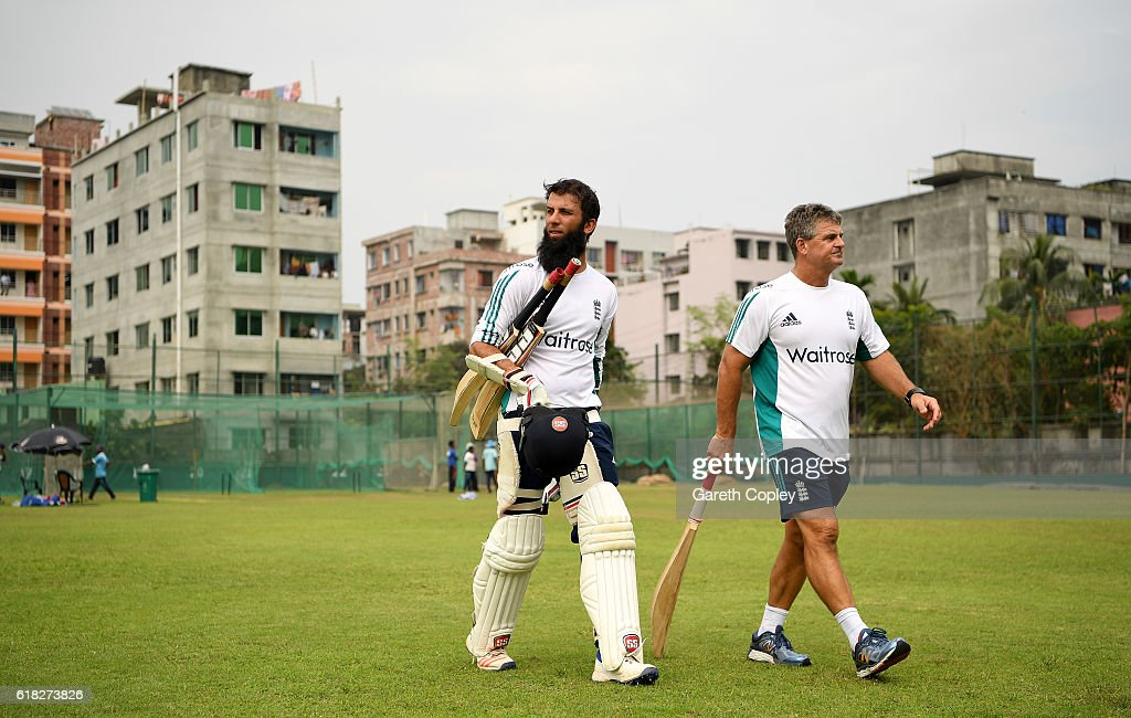 Moeen Ali of England with coach Steve Rhodes during a nets session at Sher-e-Bangla National Cricket Stadium on October 26, 2016 in Dhaka, Bangladesh.
