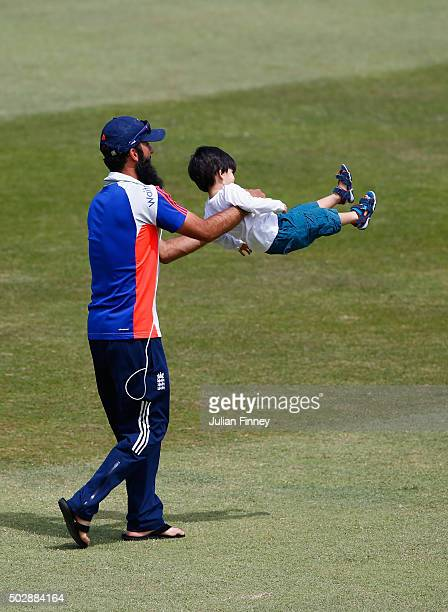 Moeen Ali of England with son Abu Bakr Ali seen on the pitch after day five of the 1st Test between South Africa and England at Sahara Stadium...