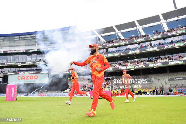 Moeen Ali of the Birmingham Phoenix leads his team out to field during The Hundred match between Birmingham Phoenix Men and Trent Rockets Men at...