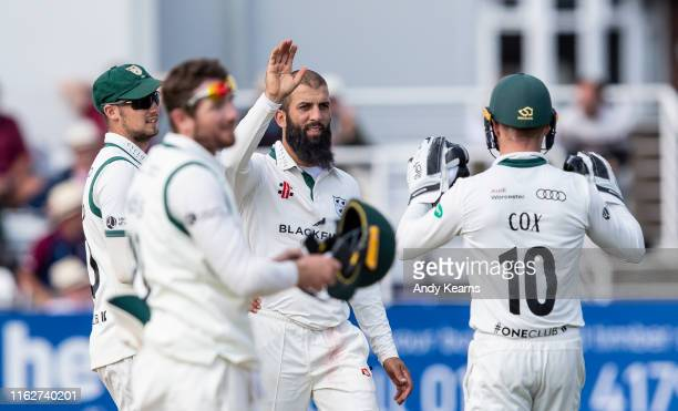 Moeen Ali of Worcestershire celebrates with his team mates after taking the wicket of Brett Hutton of Northamptonshire during the Specsavers County...