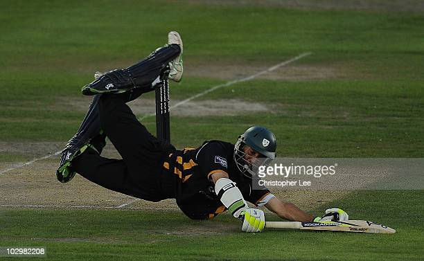 Moeen Ali of Worcestershire dives to staying in during the Clydesdale Bank 40 match between Sussex and Worcestershire at the County Ground on July 19...