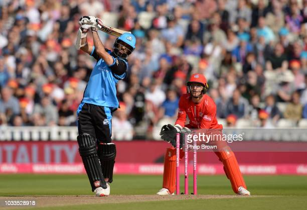 Moeen Ali of Worcestershire hits a six watched by Jos Buttler of Lancashire during the Vitality T20 Blast first semifinal between Worcestershire...