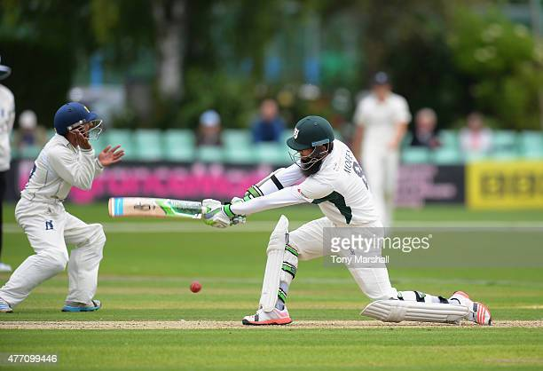 Moeen Ali of Worcestershire hits out past Ateeq Javid of Warwickshire during the LV County Championship match between Worcestershire and Warwickshire...