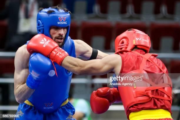 Moein Hajizadeh Sirchi of Iran competes against Sadik Pehlivan of Turkey in the Men's Wushu 52kg Final during day eleven of Baku 2017 4th Islamic...
