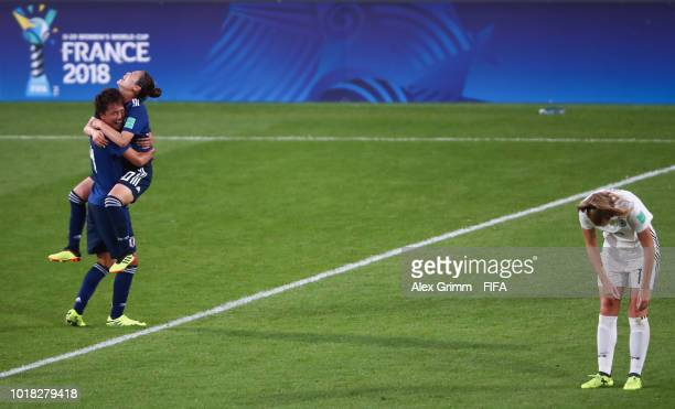 Moeka Minami and Fuka Nagano of Japan celebrate as Annalena Rieke of Germany reacts after the FIFA U20 Women's World Cup France 2018 Quarter Final...