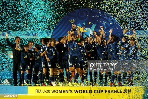 Moeka Minami of Japan lifts the trophy as Japan celebrate victory following the FIFA U20 Women's World Cup France 2018 Final match between Spain and...