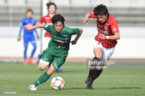 Moeka Minami of Urawa Red Diamonds Ladies and Rikako Kobayashi NTV Beleza compete for the ball the Nadeshiko League match between Urawa Red Diamonds...