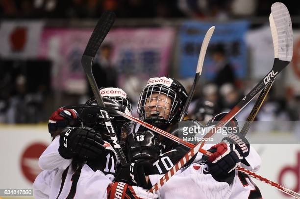 Moeko Fujimoto of Japan celebrates scoring a goal with team mates during the Women's Ice Hockey Olympic Qualification Final game between Japan and...