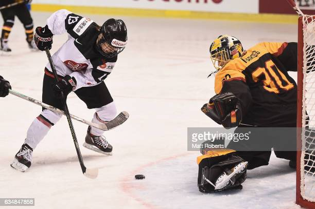 Moeko Fujimoto of Japan scores a goal during the Women's Ice Hockey Olympic Qualification Final game between Japan and Germany at Hakucho Arena on...