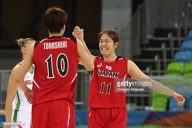 Moeko Nagaoka of Japan celebrates with Ramu Tokashiki after scoring against Belarus during a Women's Basketball Preliminary Round game on Day 1 of...