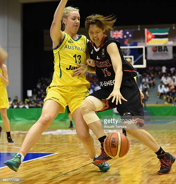 Moeko Nagaoka of Japan controls the ball against Rachel Jarry of Australia during the women's basketball international friendly match between Japan...