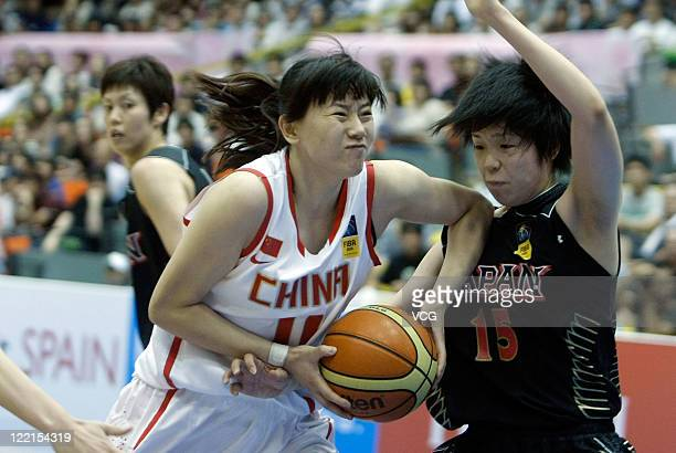 Moeko Nagaoka of Japan defends against Ma Zengyu of China in the group match during the 2011 FIBA Asia Championship For Women at Sea Hat on August...