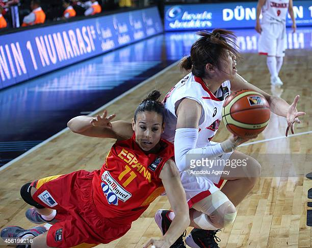 Moeko Nagaoka of Japan in action against Nuria Martinez of Spain during the 2014 FIBA World Championship For Women Group A basketball match between...