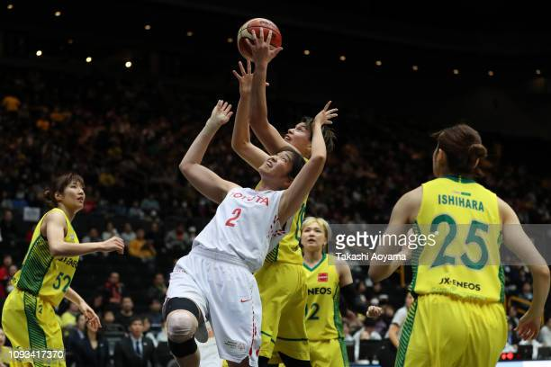 Moeko Nagaoka of Toyota Antelopes and Ramu Tokashiki of JX-Eneos Sunflowers contest for a rebound during the Basketball 85th Empress's Cup Final...