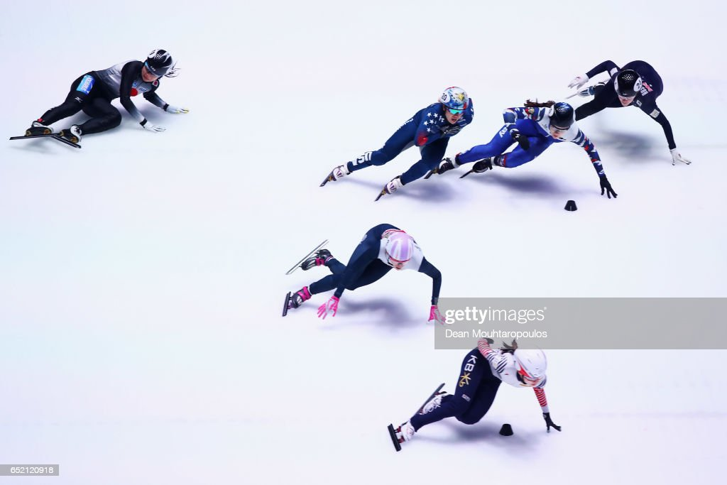 Moemi Kikuchi (L) of Japan falls on the ice and crashes out of the 1500m Semifinals race at ISU World Short track Speed Skating Championships held at the Ahoy on March 11, 2017 in Rotterdam, Netherlands.