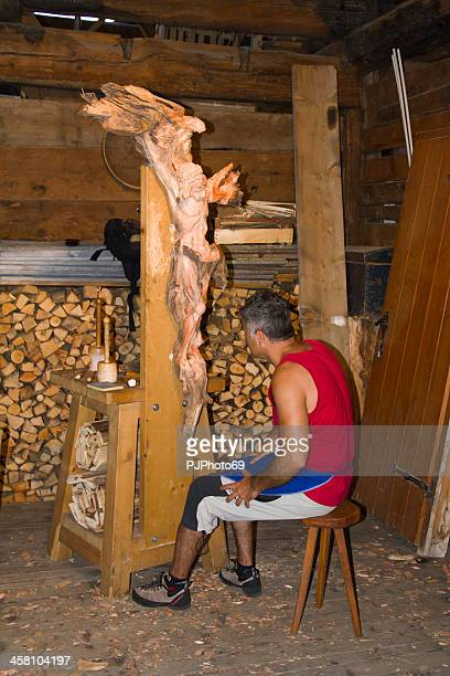 moena (dolomites) - scupltor builds a wooden crucifix - pjphoto69 stock pictures, royalty-free photos & images