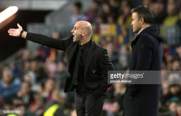 Moenchengladbach coach Andre Schubert and Barcelona coach Luis Enrique pictured during the Champions League football match between FC Barcelona and...