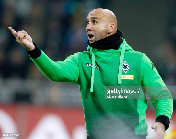Moenchengladbach coach Andre Schubert gestured during the German Bundesliga football match between Borussia Moenchengladbach and Borussia Dortmund at...