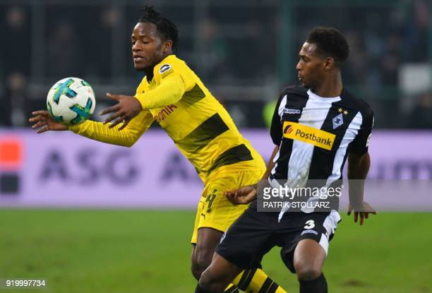 Moenchengladbach English defender Reece Oxford and Dortmund's Belgian striker Michy Batshuayi vie for the ball during the German first division...