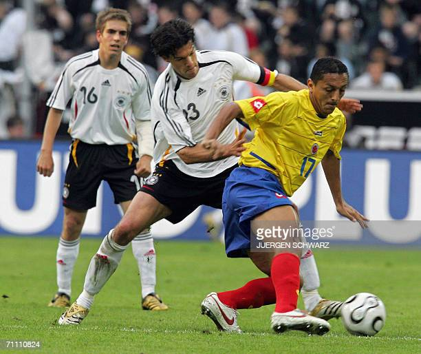 Germany's Michael Ballack vies for the ball against Colombia's Jairo Patino as Germany's Philipp Lahm looks on during a friendly football match in...