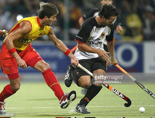 Spain's Pol Amat gets his stick stuck between Germany's Tibor Weissenborn's legs during the Germany vs Spain Field Hockey World Cup semifinal match...