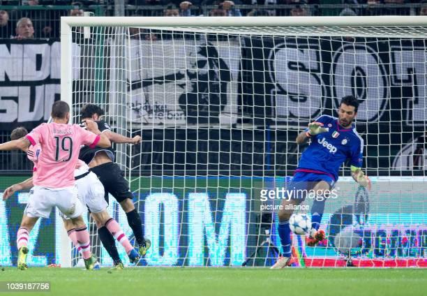 Moenchengladbach Lars Stindl and Turin's Stephan Lichtensteiner Leonardo Bonucci and goalkeeper Gianluigi Buffon in action during the Champions...