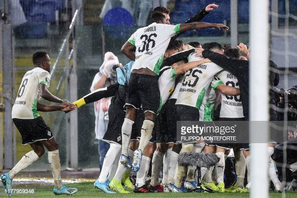 Moenchengladbach players celebrate after scoring a last minute penalty during the UEFA Europa League Group J football match AS Roma vs Borussia...