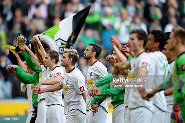Moenchengladbach players celebrate after the Bundesliga match between VfL Borussia Moenchengladbach and Eintracht Frankfurt at Borussia Park Stadium...
