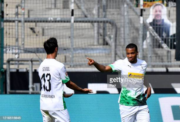 Moenchengladbach's Alassane Plea, right, celebrates with Moenchengladbach's Lars Stindl after scoring his side's fourth goal during the Bundesliga...